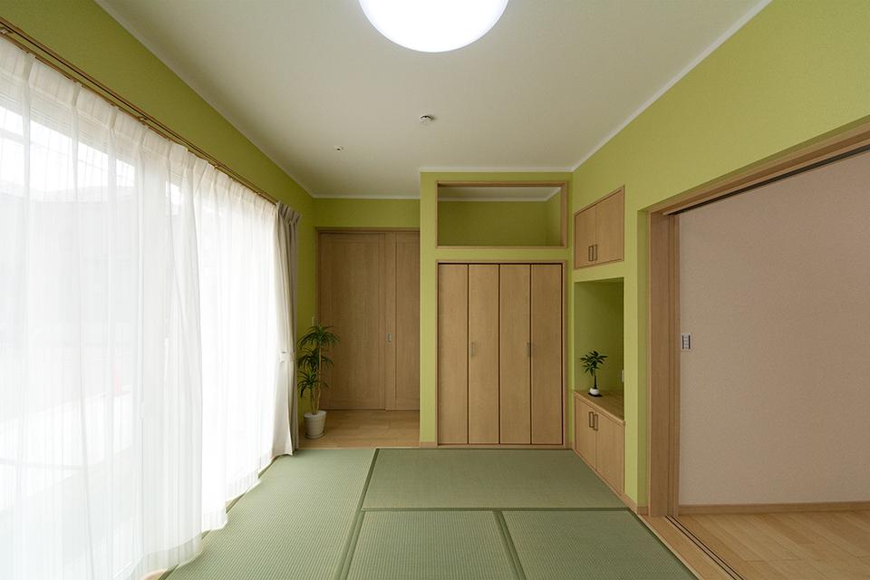 畳のさわやかなグリーンが空間を彩る1階畳敷き洋室。グリーンのアクセントクロスが印象的です。