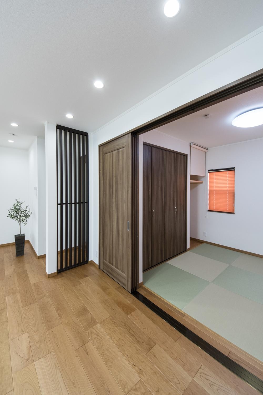 2F畳敷洋室(子世帯)/爽やかなグリーンの畳を市松敷きにしたモダンな空間。